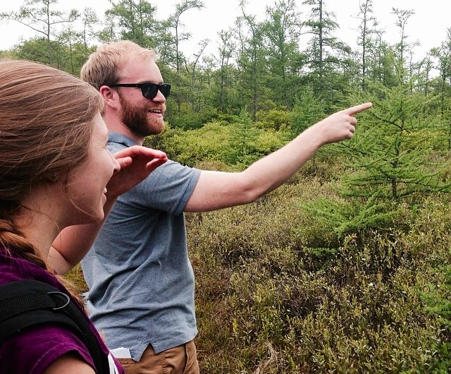 Pointing out something awesome at the Portage Bog.